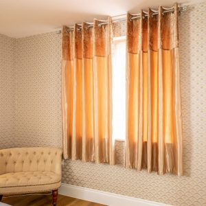 The London Linens Co® Crushed Velvet Band Faux Silk Eyelet Curtains