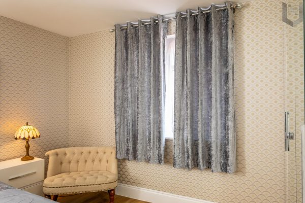 The London Linens Co® Crushed Velvet Eyelet Ring Top Pair of Fully Lined Curtains